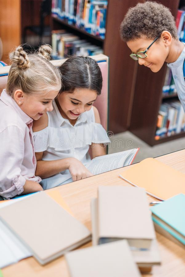 funny little kids reading book royalty free stock photo
