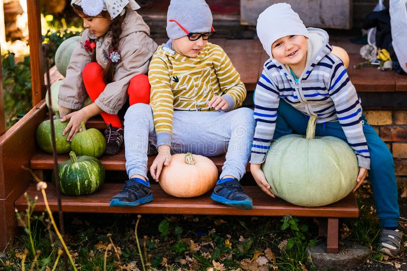 Funny kids are preparing for Halloween stock photo