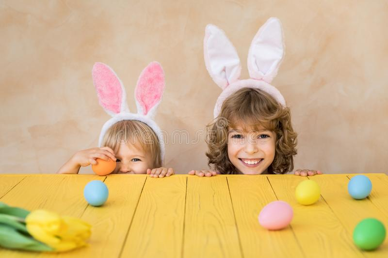Funny kids wearing Easter bunny stock photo