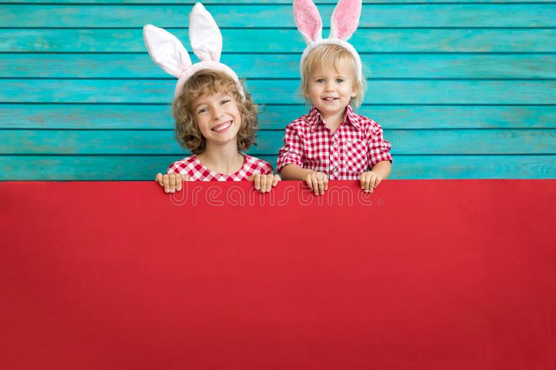 Funny kids wearing Easter bunny royalty free stock photo