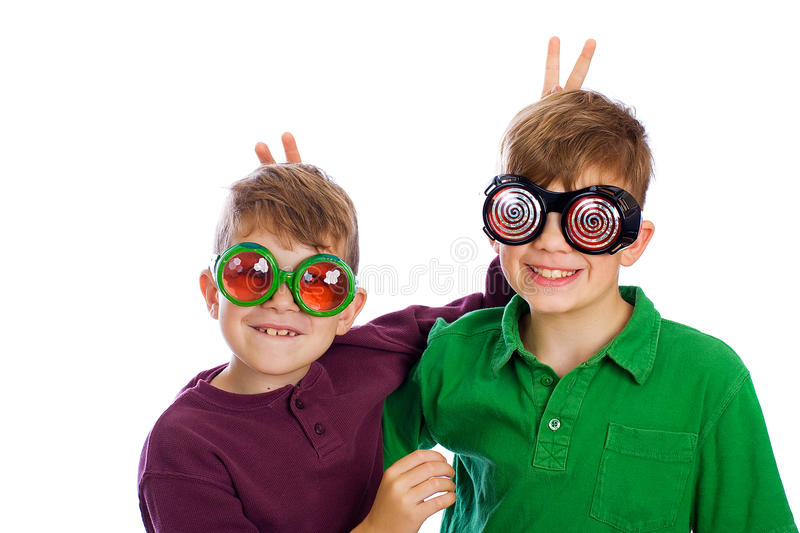 Funny kids wearing novelty glasses stock images
