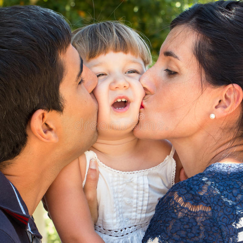 Funny kissing family stock images