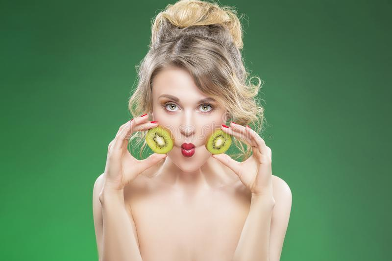 Funny Kiwi Fruit Series. Sensual Funny Nude Caucasian Model Making Faces royalty free stock images