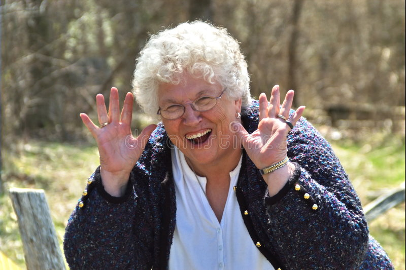 Funny lady. Senior woman being silly stock photos