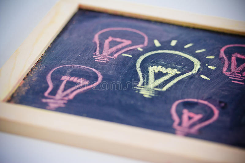 Download Funny Lightbulb On Blackboard, Concept Of Uniqueness Stock Image - Image: 29194065