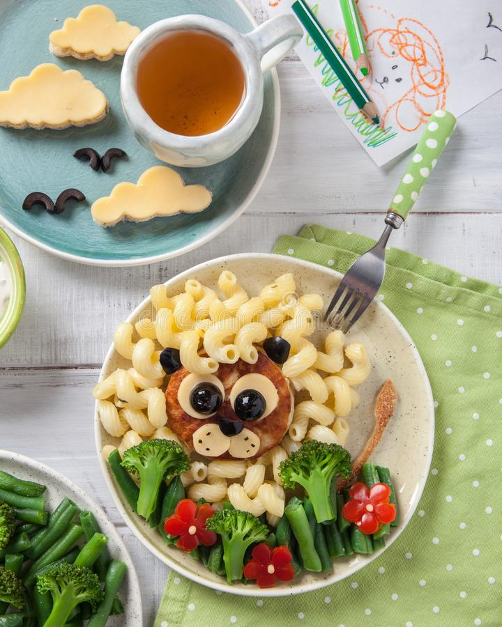 Funny Lion Food Face with Cutlet, Pasta and Vegetables. Funny Girl Food Face with Cutlet, Pasta and Vegetables for kids lunch royalty free stock image