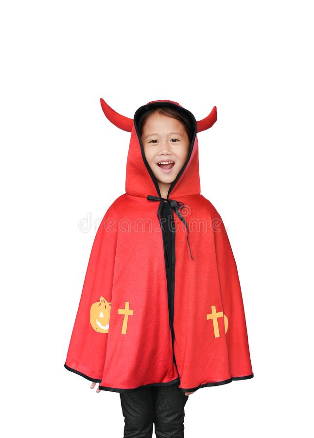 Funny little Asian child girl dressed Halloween costume. Kid in Dracula robe isolated on white background stock photo