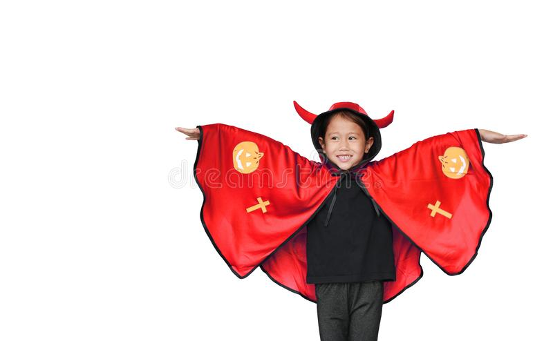 Funny little Asian child girl dressed Halloween costume with looking up. Kid in Dracula robe isolated over white background with stock photos