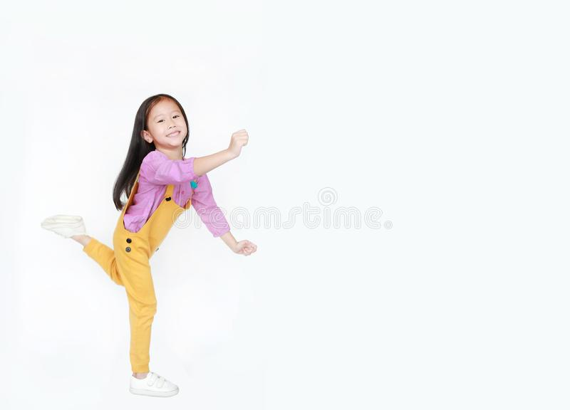 Funny little Asian child girl isolated on white background with copy space. Happy and smiling shot.  stock images