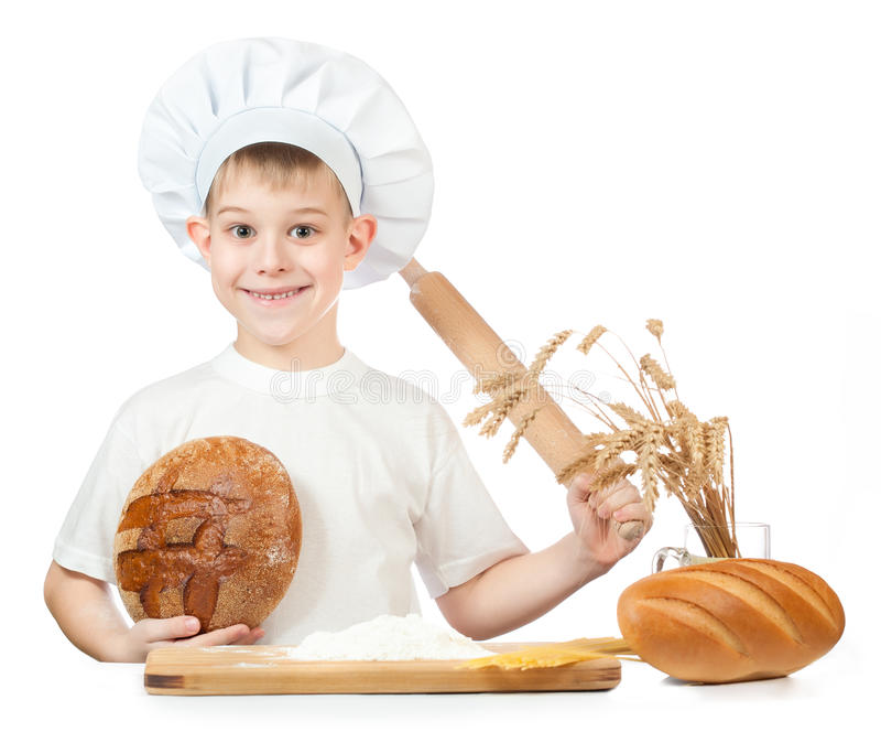 Funny little baker is kneading dough
