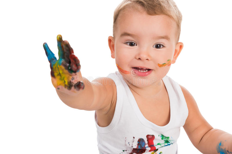 Funny little boy with colored hand royalty free stock photography