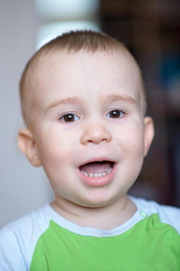 Funny little boy showing emotions, laughing. Caucasian child 2 years old. Closeup portriat. stock photo