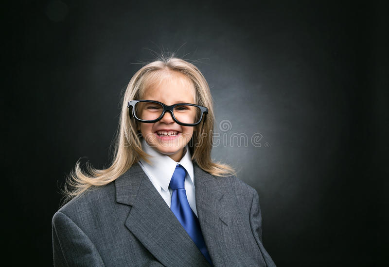Funny little business girl. With long hair royalty free stock photo