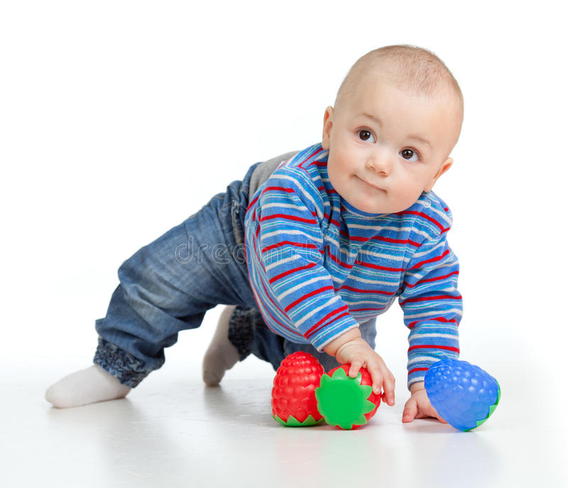 Funny little child playing with color toys. Funny baby playing with toys over white stock photos