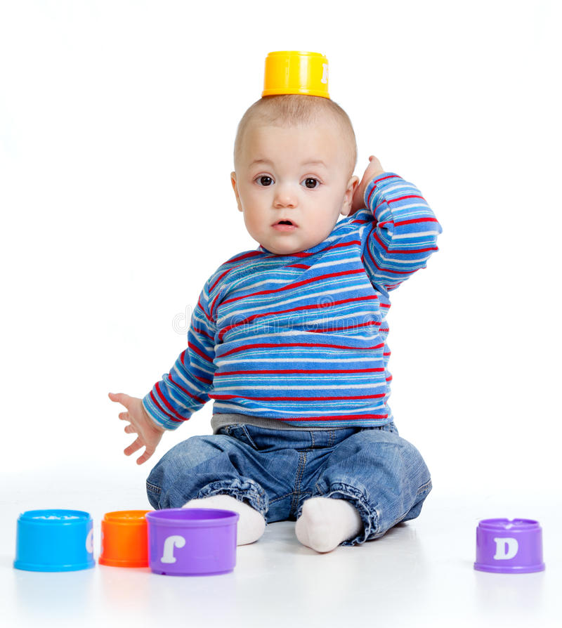 Funny little child is playing with cup toys. Funny little child is playing with toys, over white royalty free stock photography