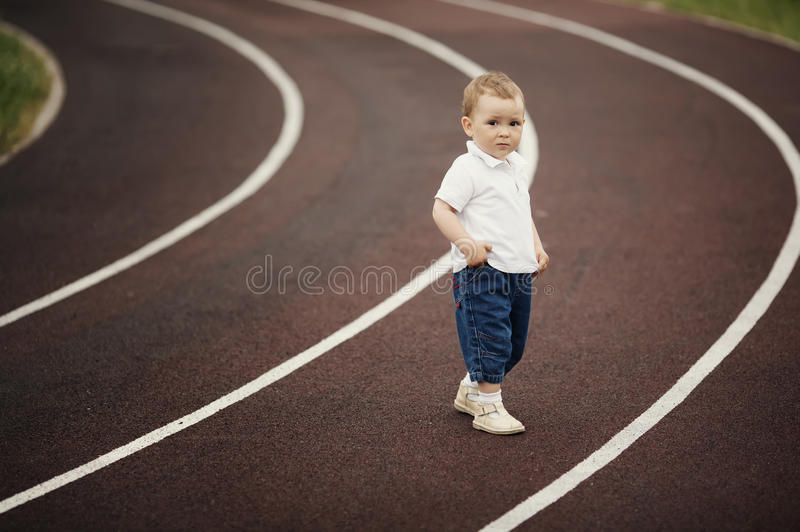 Funny children playing on stadium stock images