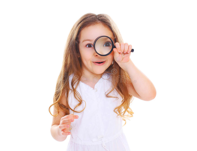 Funny little girl child looking through magnifying glass on white. Funny little girl child looking through a magnifying glass on white background royalty free stock photo