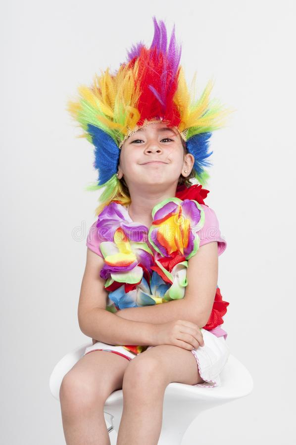 Funny little girl in disguise with wig royalty free stock photo