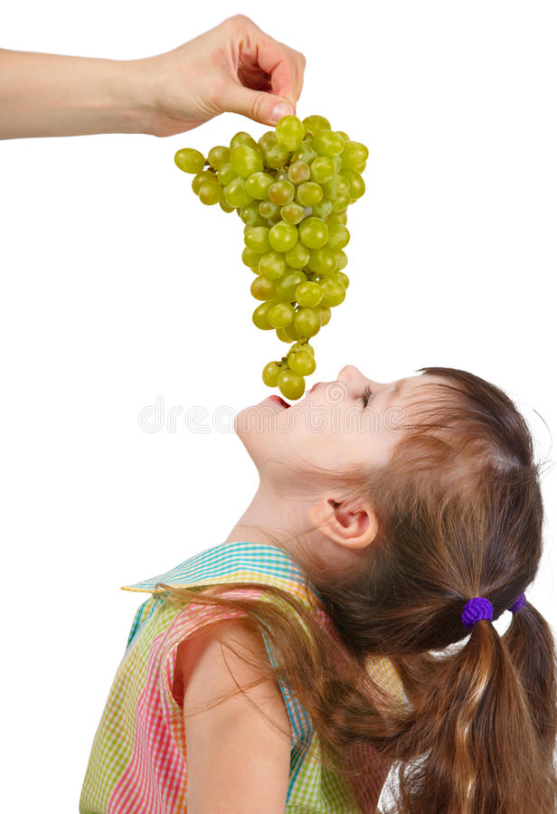 Free Funny Little Girl Eating Grapes From Hand Stock Image - 13935611