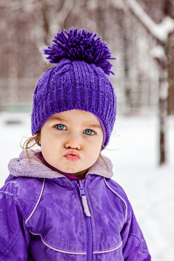 Funny little girl emotional portrait, closeup. Child walking outside. stock photo