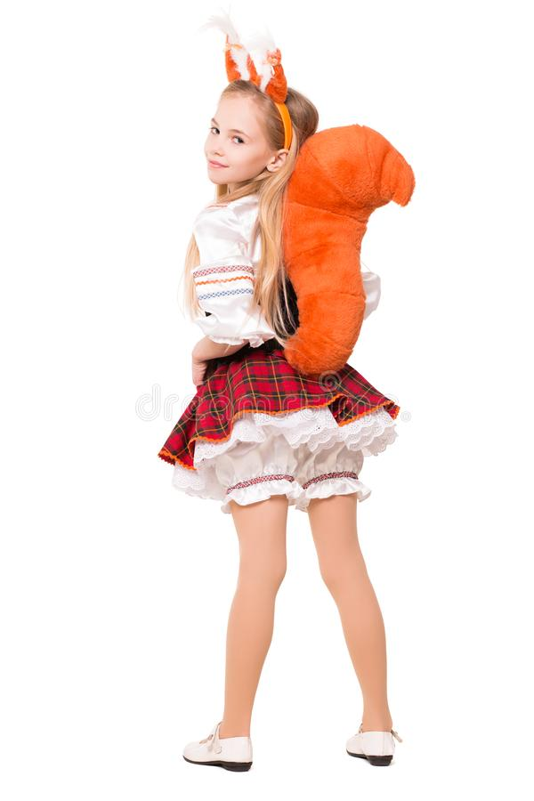 Funny little girl. Wearing like a squirrel showing her tail. Isolated on white stock images