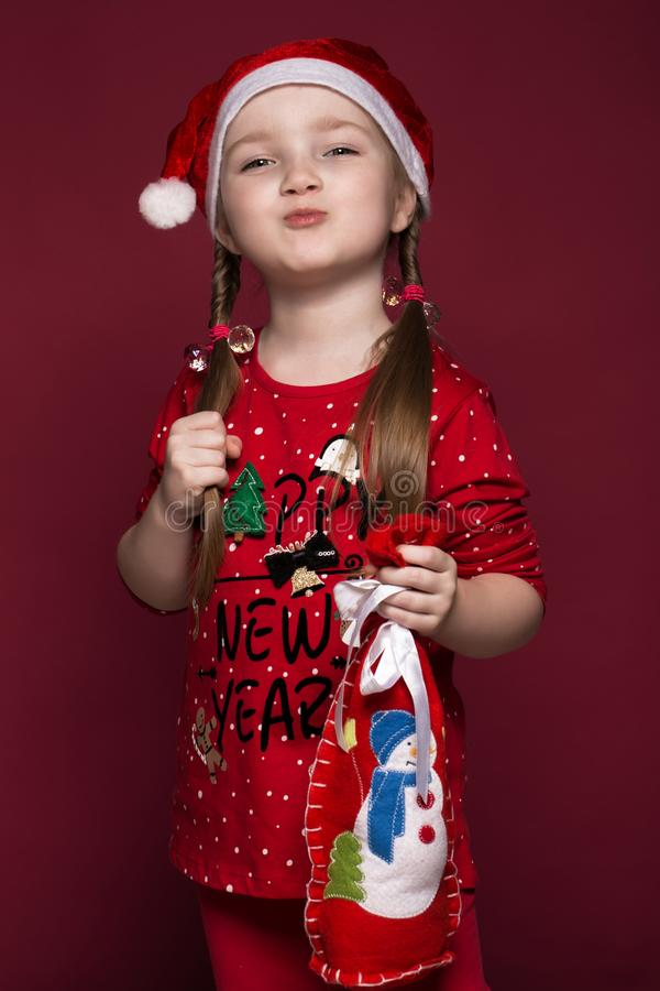 Funny little girl in the New Year`s image, showing different emotions. Photo taken in studio royalty free stock photography