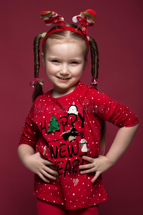 Funny little girl in the New Year`s image, showing different emotions. Photo taken in studio royalty free stock images