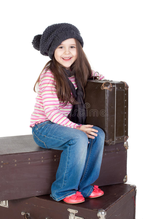 Funny Little Girl With The Old Suitcases Royalty Free Stock Photo