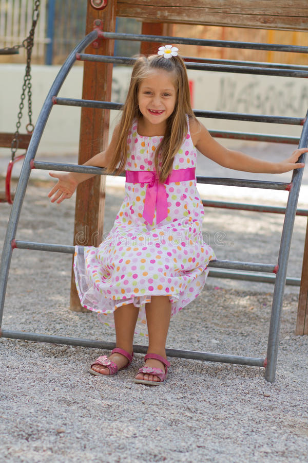 Free Funny Little Girl On The Playground Stock Photography - 27439702
