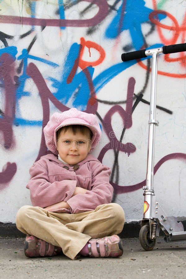 Download Funny Little Girl With Scooter Near Graffiti Wall Stock Image - Image: 9087171