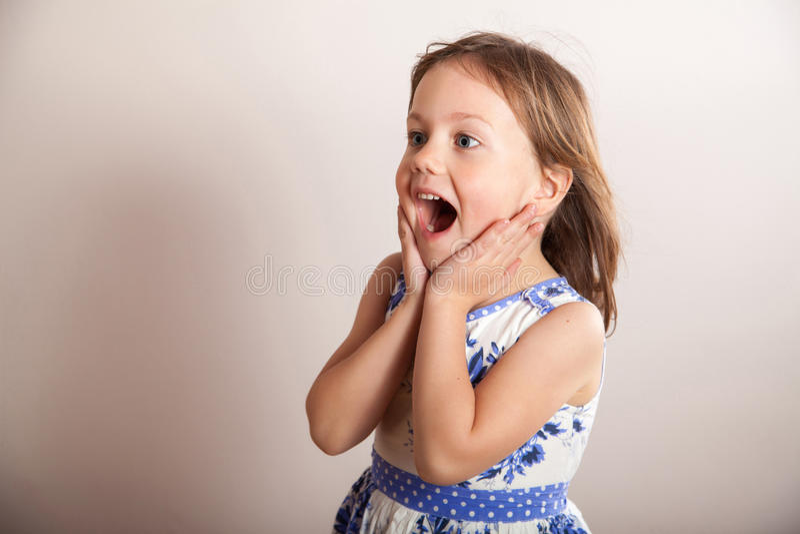 Funny little girl screaming aloud. Portrait stock photo