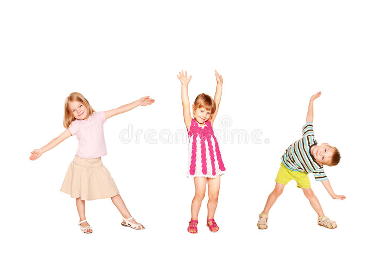 Funny little kids dancing. Isolated on white royalty free stock photo