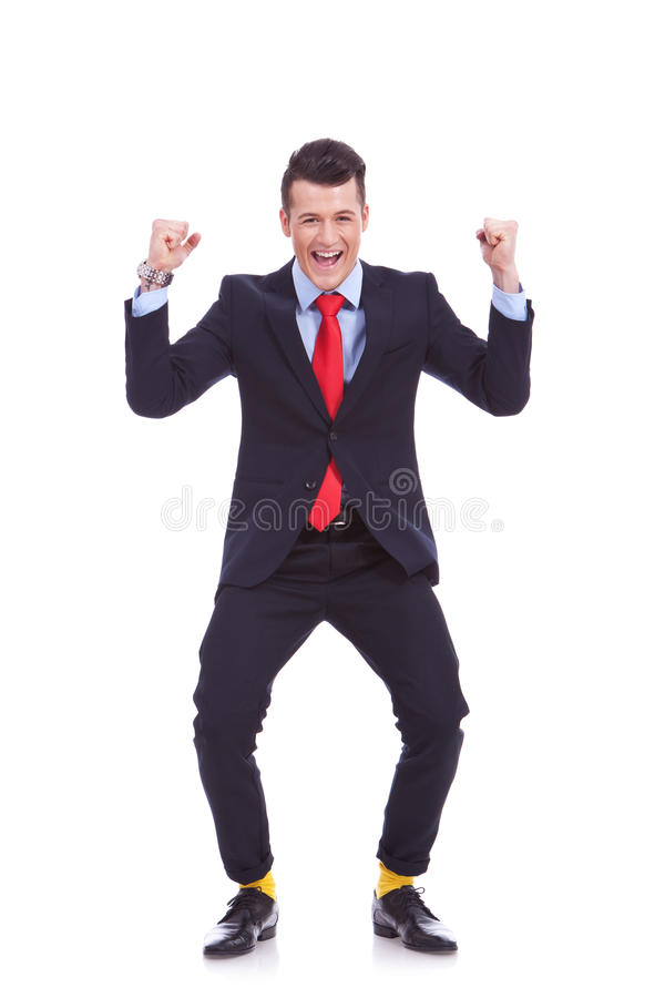 Funny looking business man winning. Funny looking business man in suit and yellow socks, winning on white background stock photo