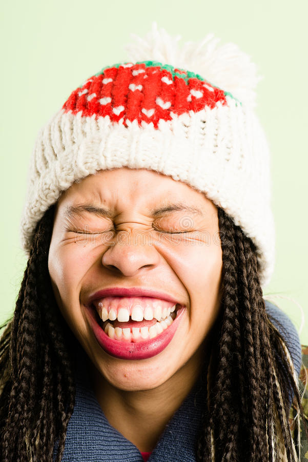 Funny woman portrait real people high definition green background. Funny looking young woman laughing portrait royalty free stock photos