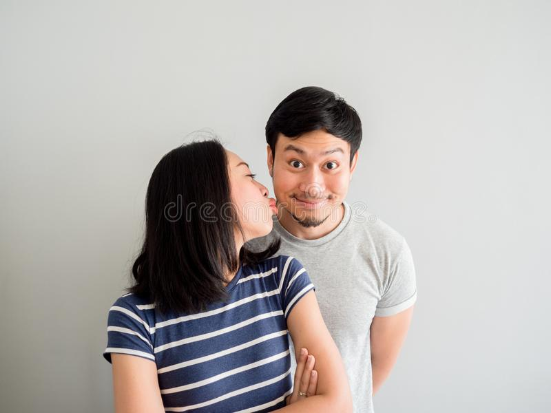 Funny lovely couple trying to kiss each other. Concept of comedy. Funny lovely Asian couple trying to kiss each other. Concept of comedy love royalty free stock images