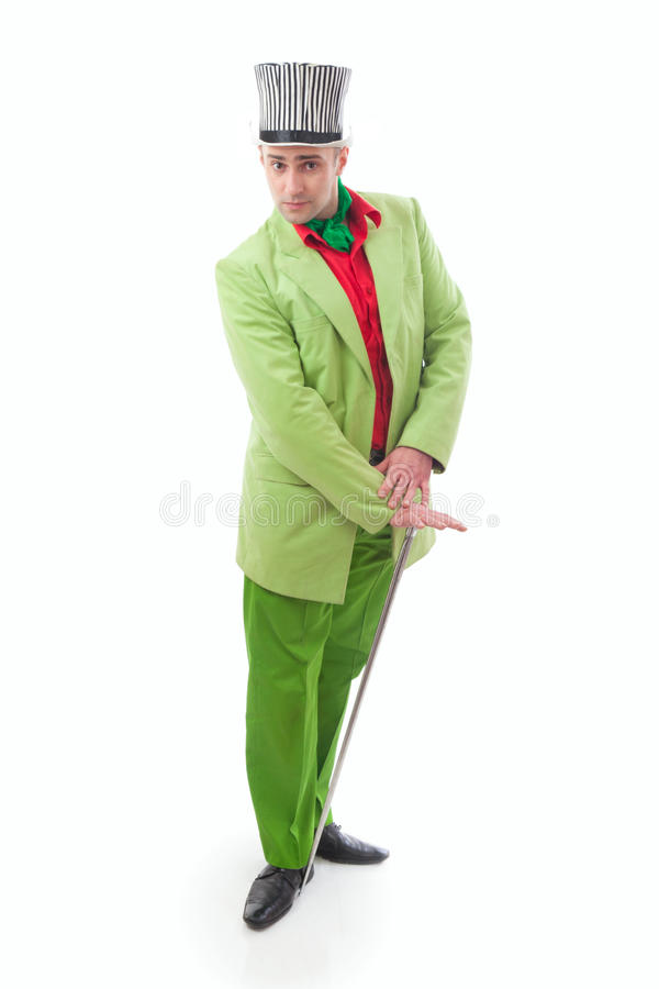 Funny magician. In a green suit on a white background stock photos