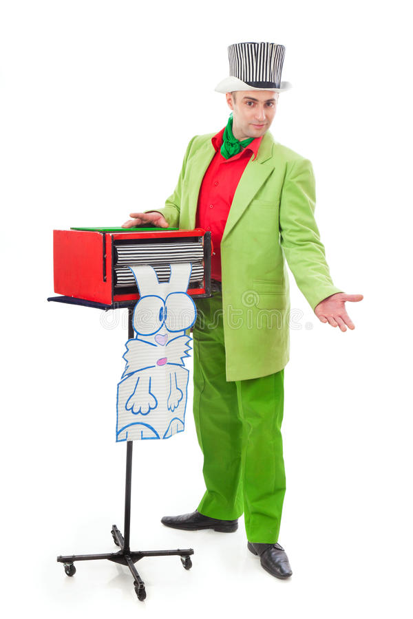 Funny magician. In a green suit on a white background royalty free stock photography