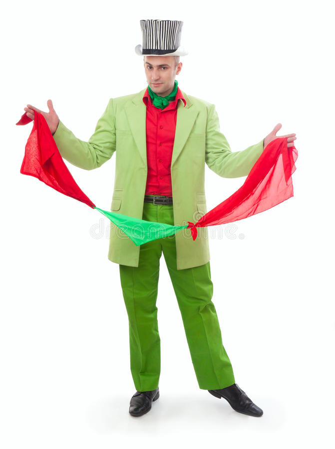 Funny magician. In a green suit on a white background royalty free stock photo