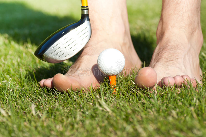 Funny Male Feets Playing With Golf Ball Royalty Free Stock Photography