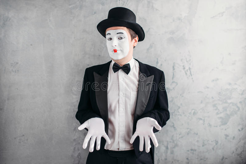 Funny male mime artist with makeup. In gloves and hat. April fools day concept stock image