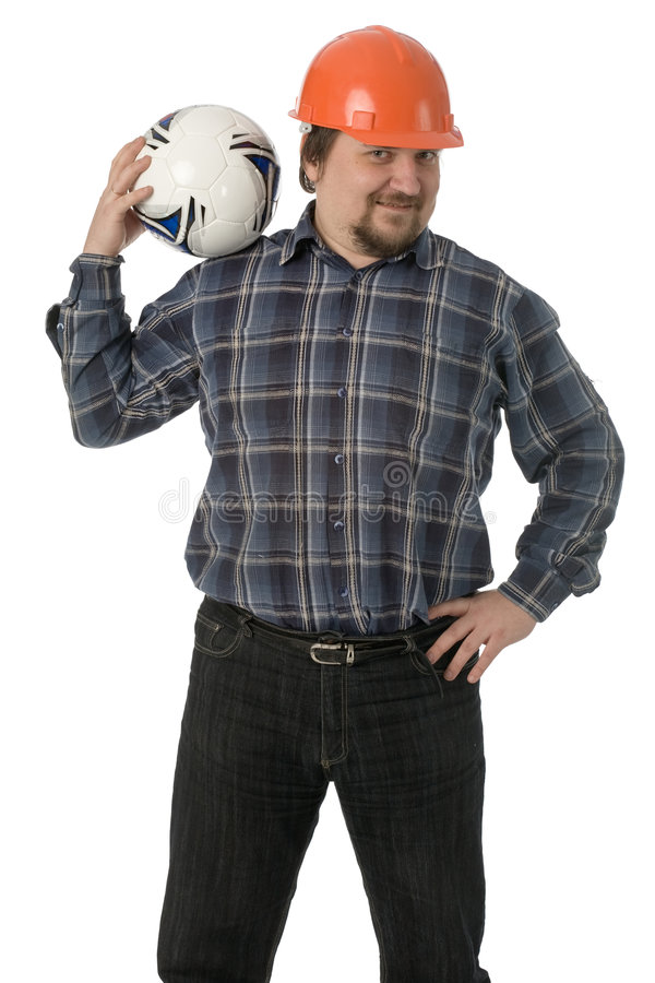Funny man. Big funny man in orange helmet with soccer ball in hand isolated on white stock photography