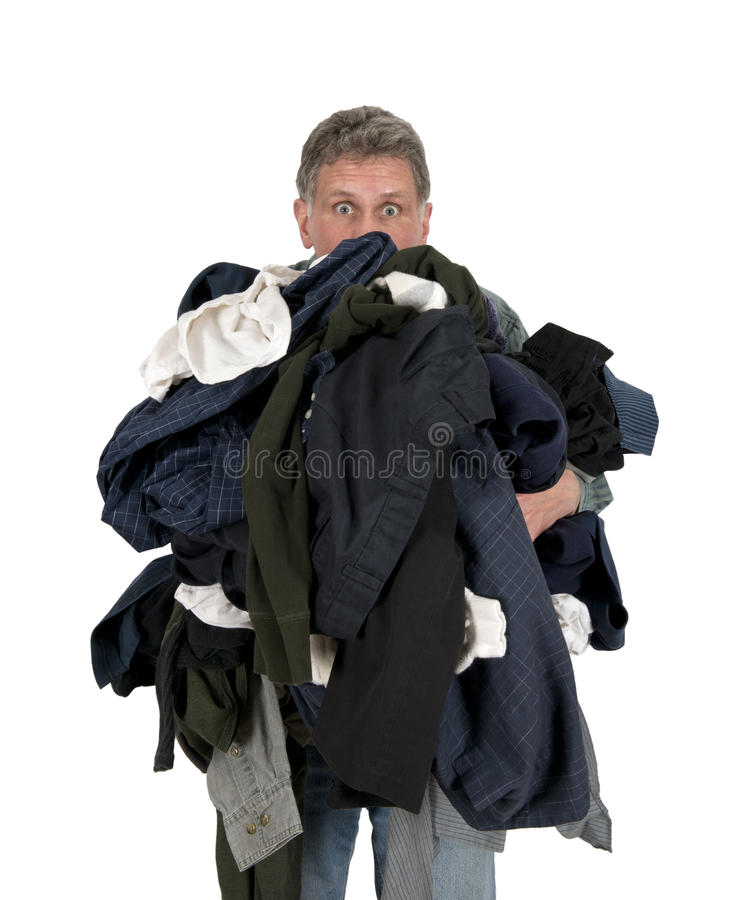 Funny Man Armload, Clothes, Dirty Laundry Isolated. Household chores suck! This funny man has an armload of dirty clothes and laundry on wash day. The male sex royalty free stock image