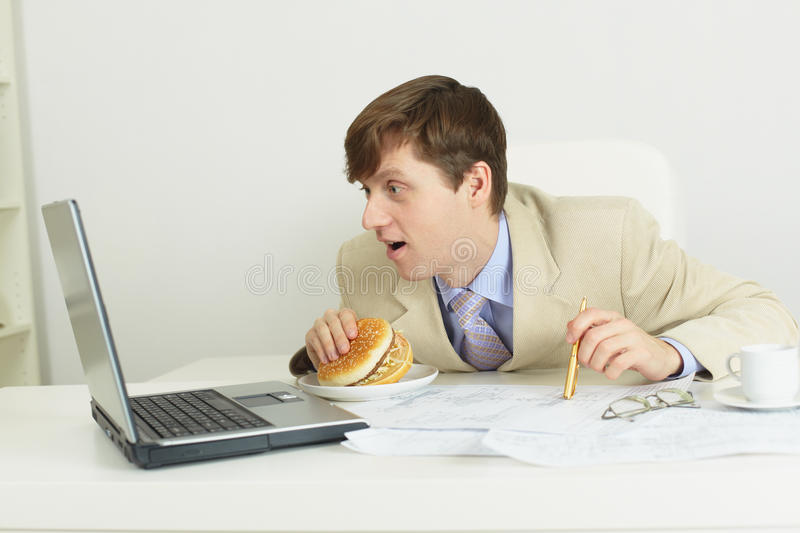 Download Funny Man With Big Sandwich At Office Stock Photo - Image: 12233578