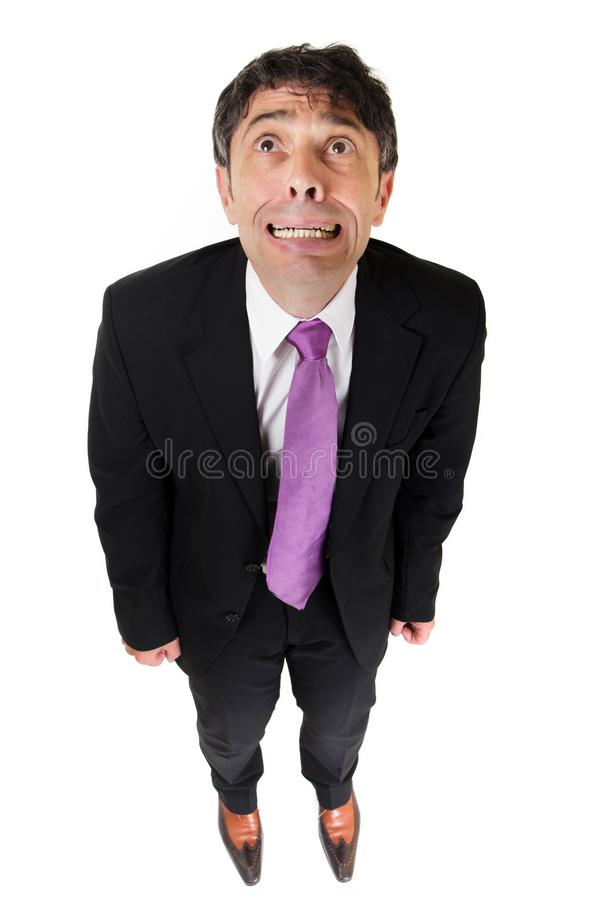 Funny man. Desperate businessman shot from above, isolated on white stock photo