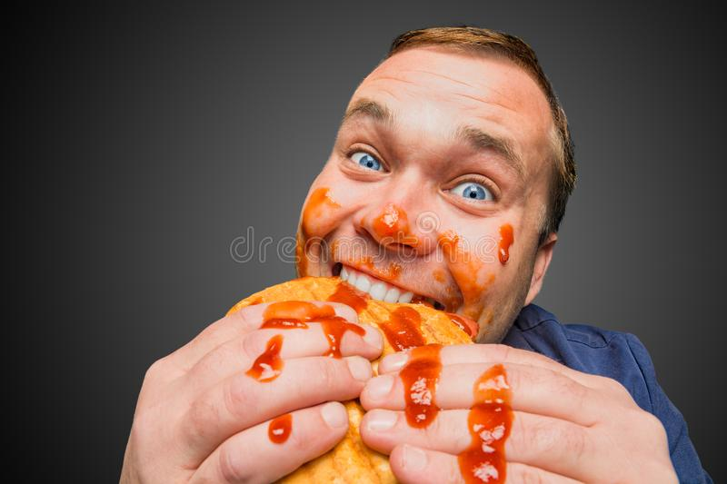Funny man eating the sandwich stock image