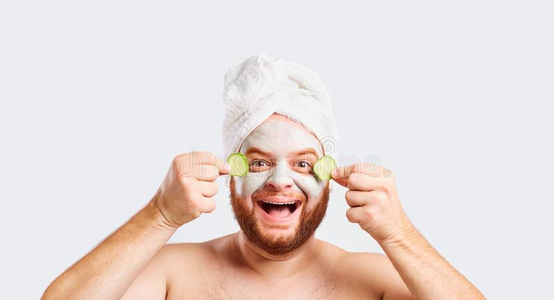 A funny man in a face mask in a beauty salon stock photo