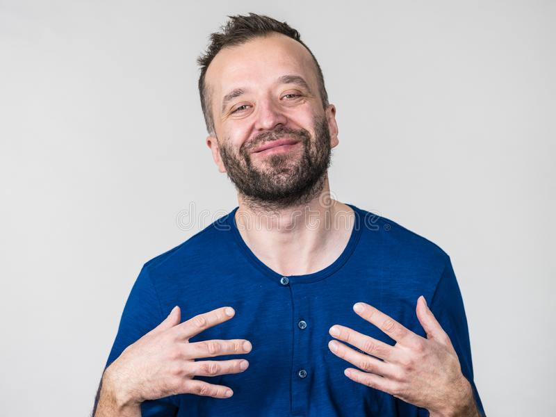 Funny man fooling around. Funny adult man, guy folling around gesturing with hands. Positive emotions concept royalty free stock photos