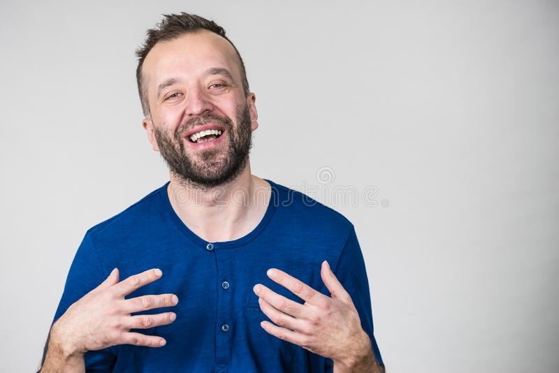 Funny man fooling around. Funny adult man, guy folling around gesturing with hands. Positive emotions concept stock image