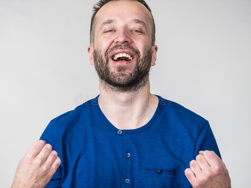 Funny man fooling around. Funny adult man, guy folling around gesturing with hands. Positive emotions concept royalty free stock images