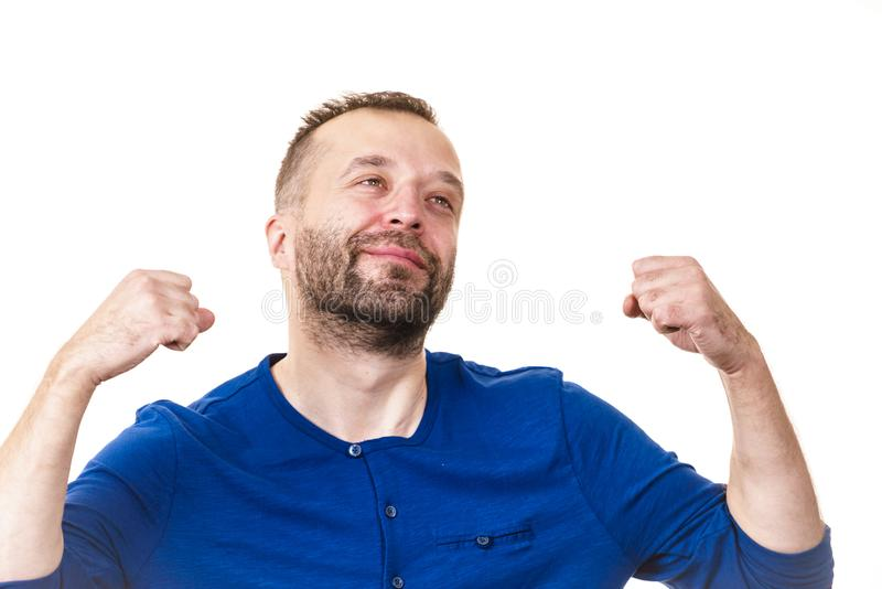 Funny man fooling around. Funny adult man, guy folling around gesturing with hands. Positive emotions concept royalty free stock photo